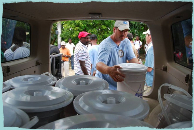 Brad Jenkins unloads water filters for the people of Munoz