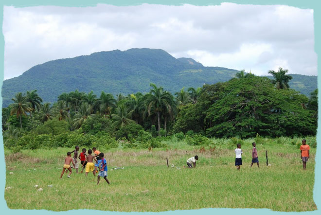 The people of Munoz clearing a field to earn their water filters