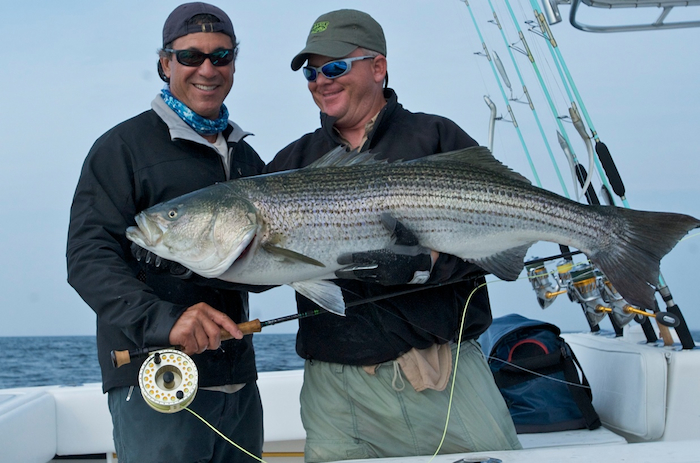 Jose with terry nugent and big striped bass caught on g for Fishing rod in spanish