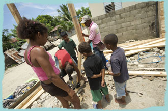 Local Javllar kids and adults help with the house build